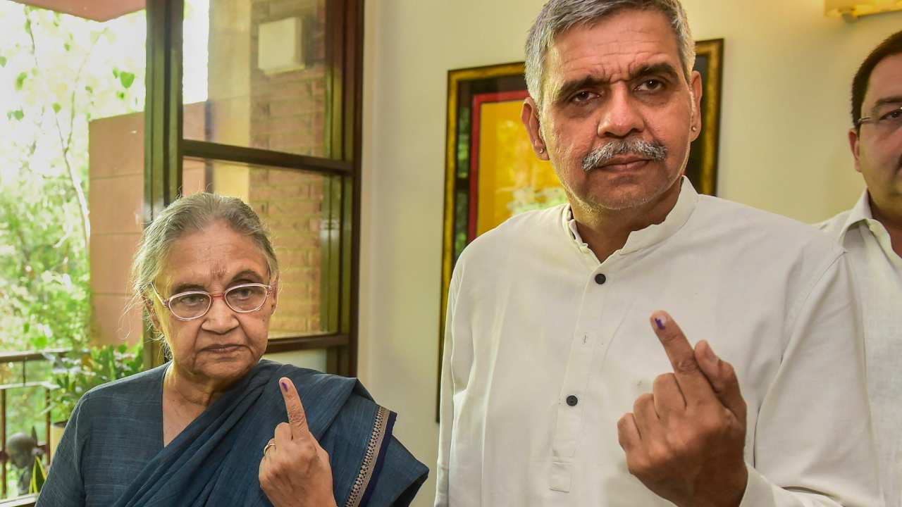 Congress' North East Delhi candidate Sheila Dikshit and her son Sandeep Dikshit after casting their vote in New Delhi. (Image: PTI)