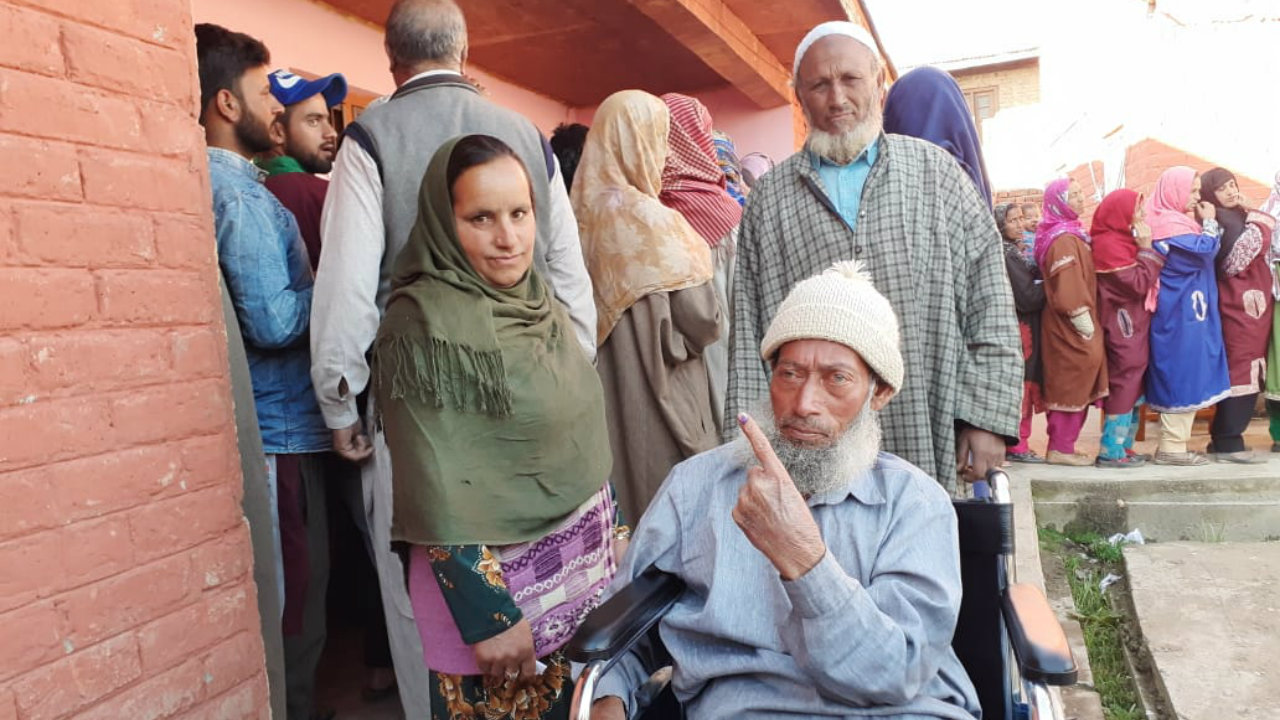 A man shows his ink-stained finger after casting his vote in Shopian, Jammu and Kashmir. Two grenade attacks were reported from J&K during polling earlier today. (Image: PIB India/Twitter)