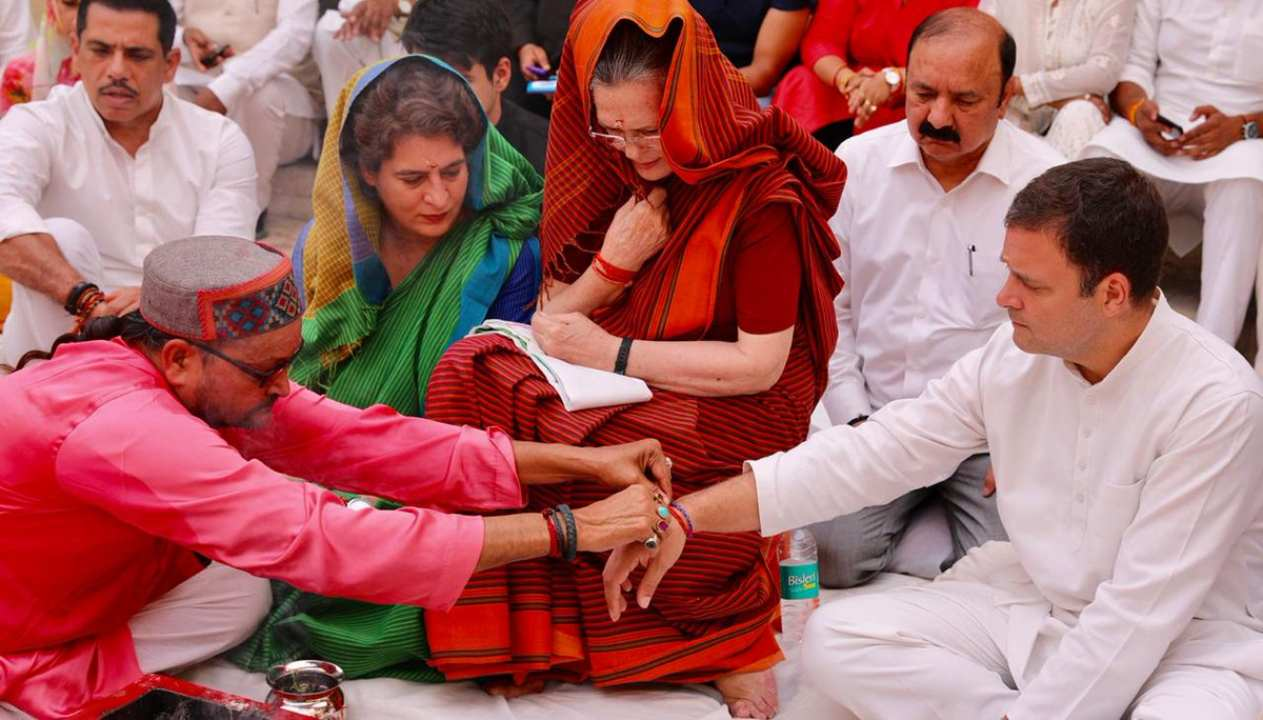 Seen here are Congress chief Rahul Gandhi, UPA Chairperson Sonia Gandhi and UP(East) Gen Secy Priyanka Gandhi offering prayers during a 'hawan' before Sonia files her nomination papers from Congress citadel Rae Bareli. Sonia has won from the seat four consecutive times. (Image: Twitter/@INCIndia)