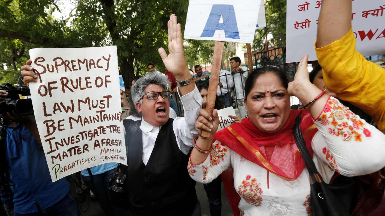 Demonstrators shout slogans during a protest after a panel of judges dismissed a sexual harassment complaint against Chief Justice of India (CJI) Ranjan Gogoi, outside Supreme Court in New Delhi. (Image: Reuters)
