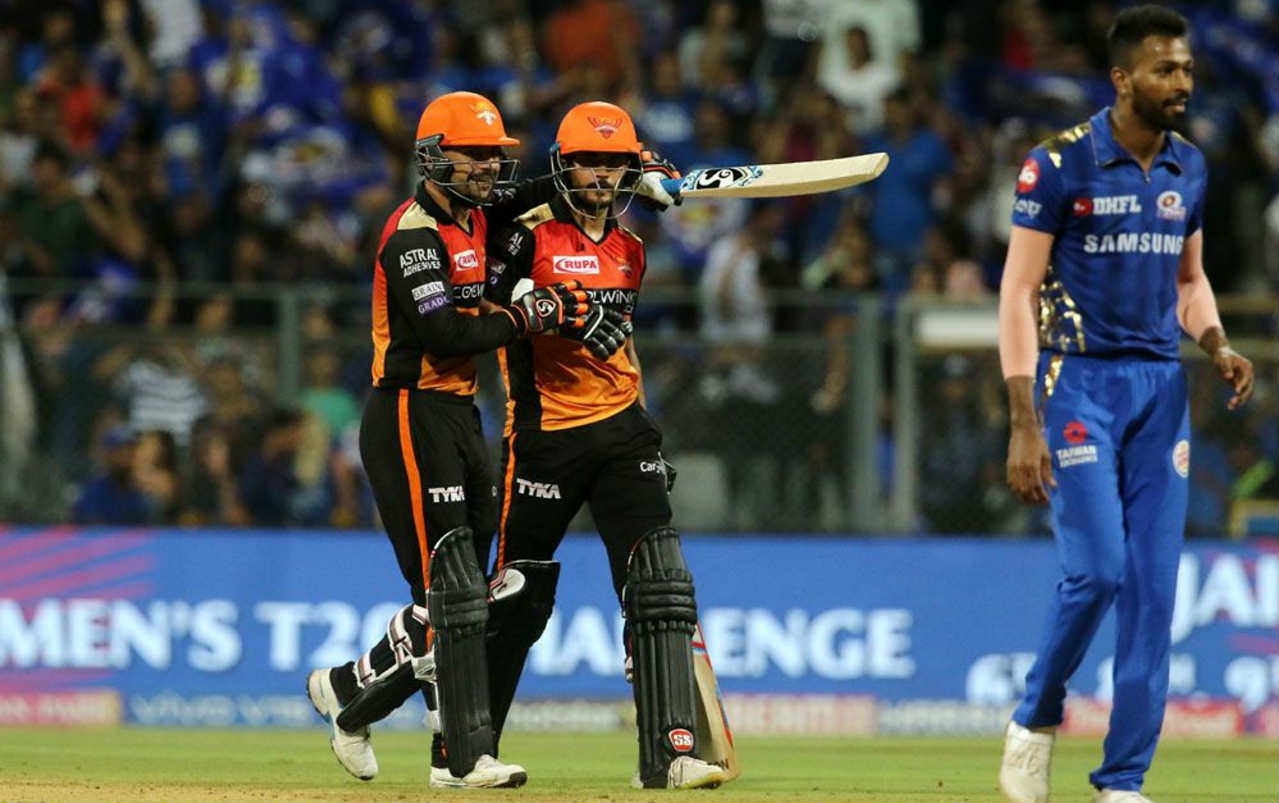 With 17 runs required off the final over MI skipper handed Hardik Pandya the ball. He got Mohammed Nabi caught out leaving SRH with 9 runs required off the last 2 balls. Pandey then took 2 runs before hitting a six off the last ball to push the game into a Super Over. (Image: BCCI, iplt20.com)