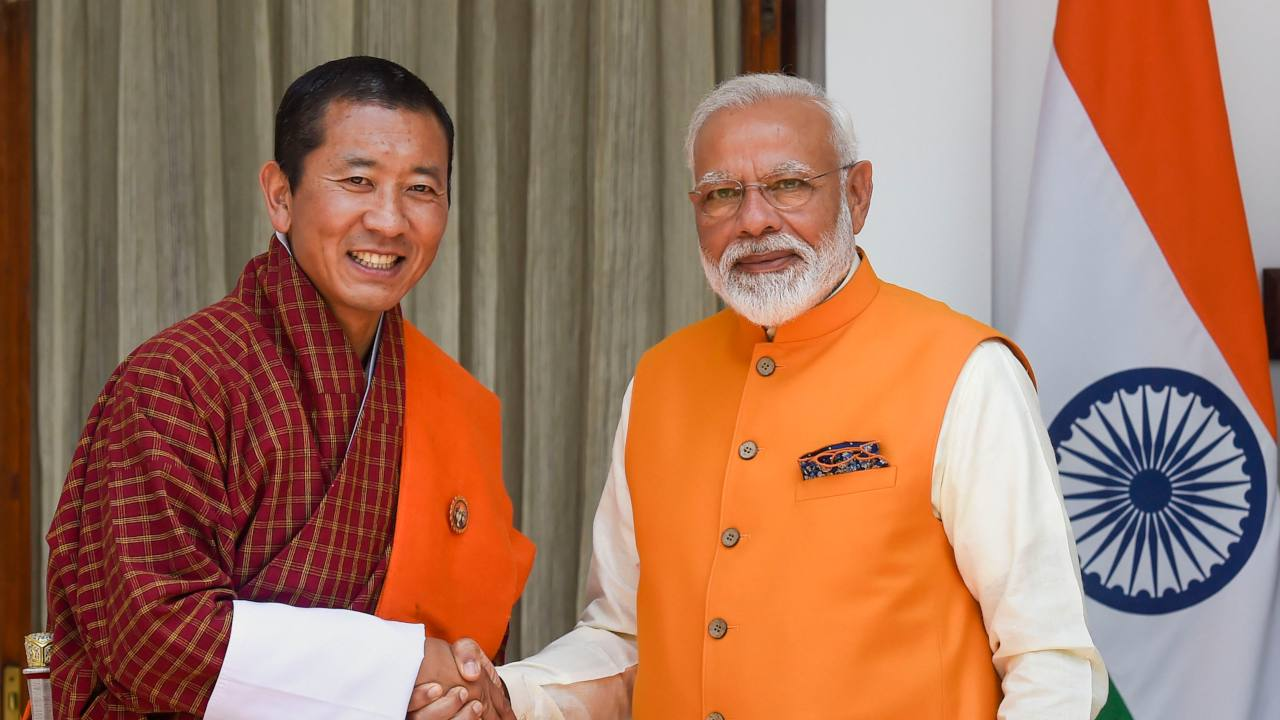Prime Minister Narendra Modi shakes hands with Bhutanese Prime Minister Lotay Tshering prior to their bilateral meeting at Hyderabad House, in New Delhi. (Image: PTI)