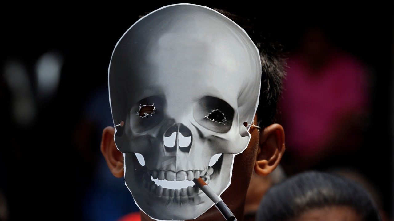 A child wearing a skull mask attends an anti-tobacco awareness rally during the World No Tobacco Day in Kolkata. (Image: Reuters)