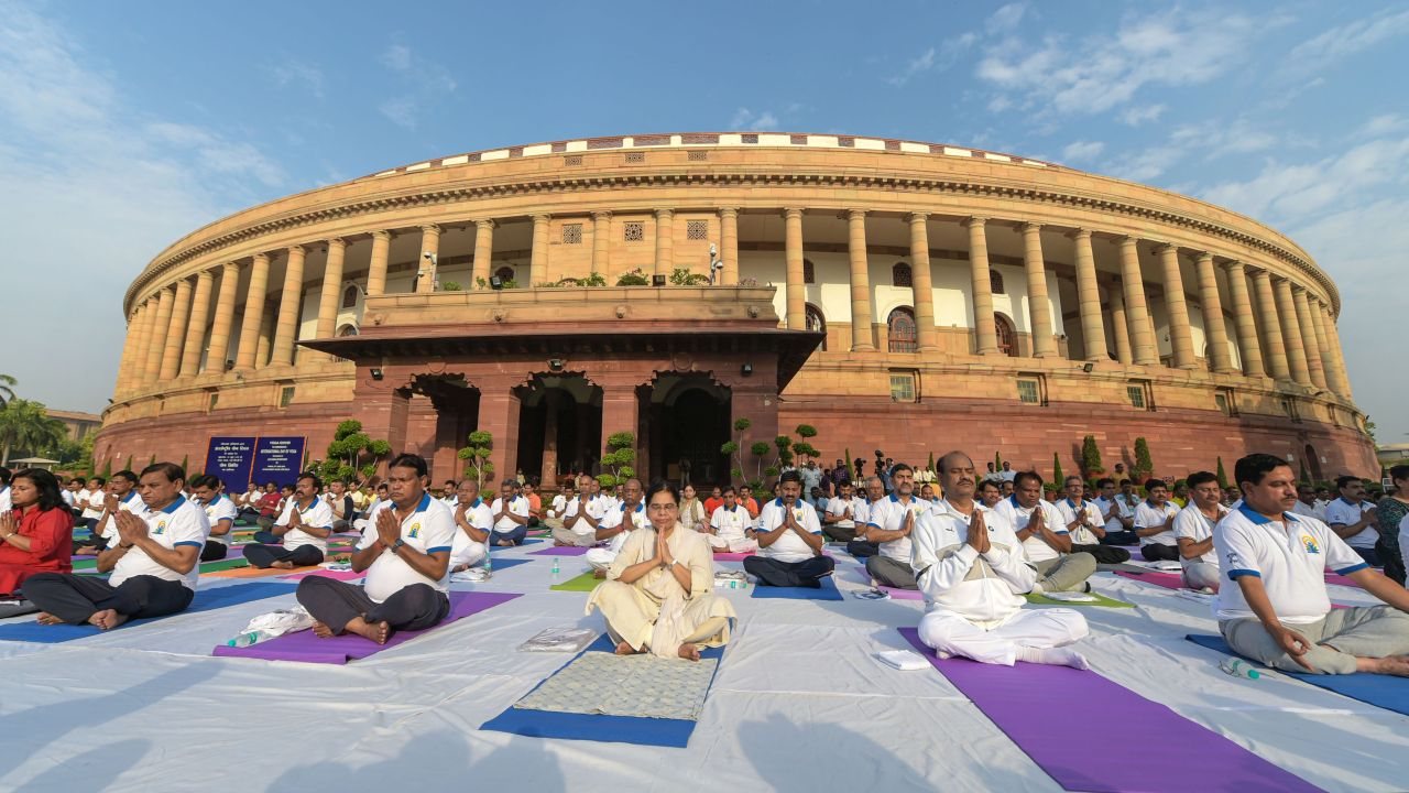Lok Sabha Speaker Om Birla, Parliamentary Affairs Minister Prahlad Joshi, BJP General Secretary Bhupender Yadav along with other MPs and officials perform Yoga during the fifth International Day of Yoga at Parliament, in New Delhi. (Image: PTI)