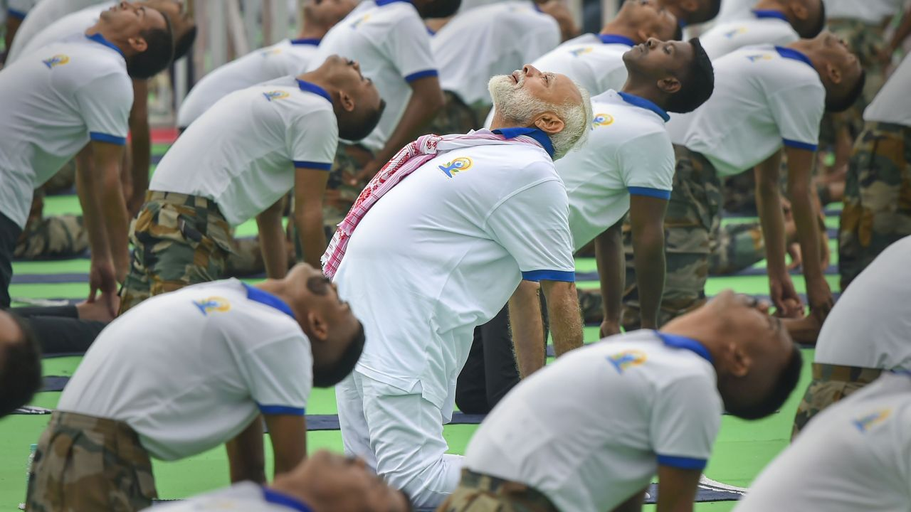 Prime Minister Narendra Modi performs yoga during a mass yoga event on the fifth International Day of Yoga at Prabhat Tara ground, in Ranchi, Jharkhand. (Image: PTI)