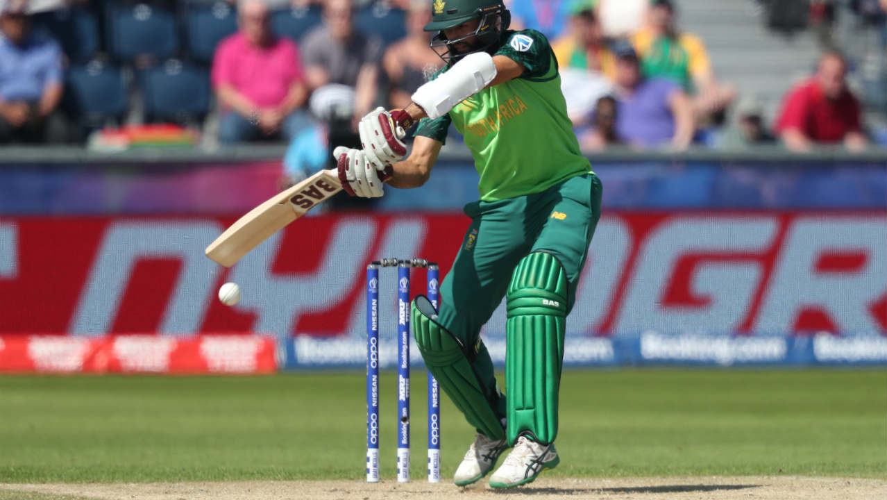 After the early loss, Amla along with Faf du Plessis stabilized the Proteas chase. Amla completed his half-century in the 20th over. (Image: Reuters)