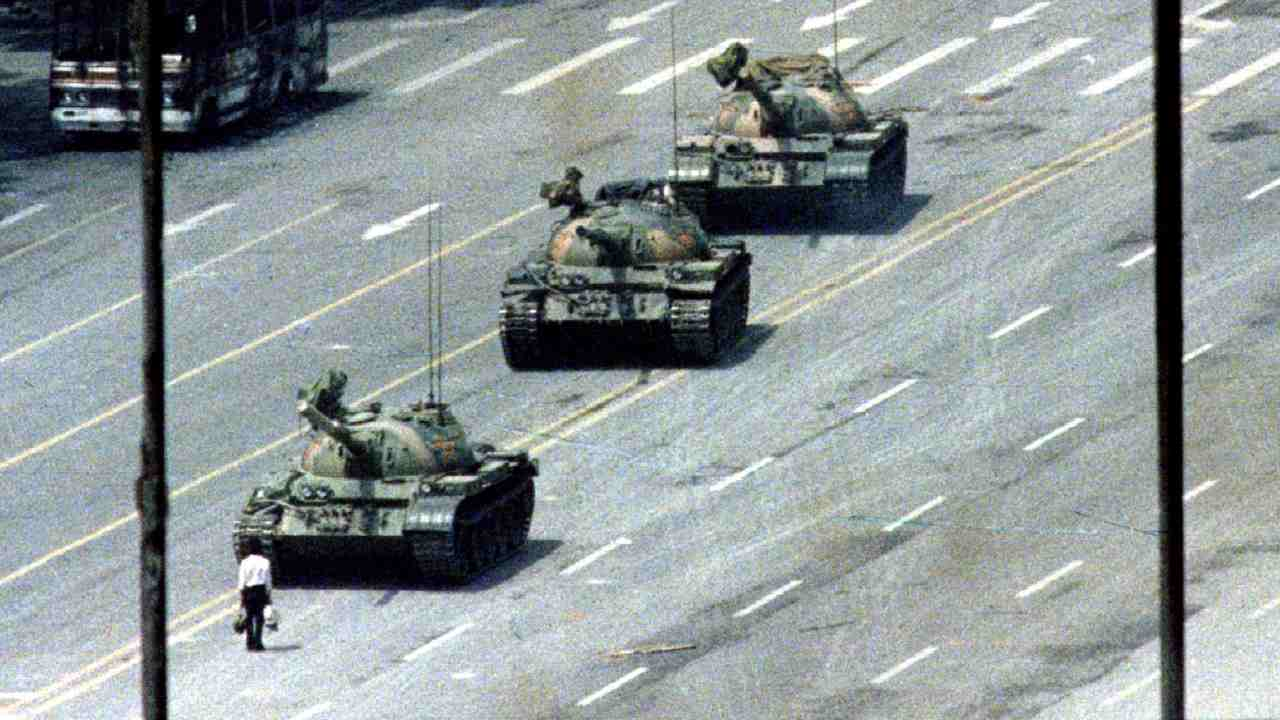 As Army tanks rolled in at Tiananmen Square, a lone man stood in front of them in an attempt to block them and in defiance of the Martial Law. The iconic image is a memoir of the massacre and the man is popularly known as 'Tank Man'. (Image: Reuters)