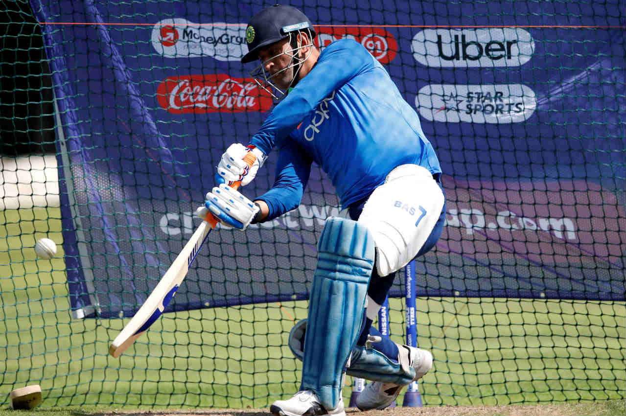 MS Dhoni practices his shots in the nets. The wicket-keeper batsman has been under pressure for his slow starts but registered a fighting half-century in India's last game against West Indies. (Image: Reuters)