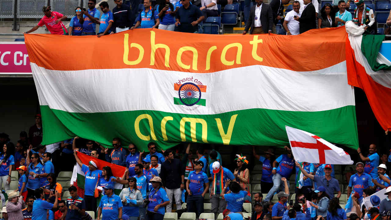 """The Indian fans were out in full strength to support their team who were up against hosts England in match 38 of the ICC Cricket World Cup 2019. The 'Men in Blue' were today clad in a new orange jersey in compliance with ICC's new rule which states that in case the kits of the playing teams are of the same colour, the """"away"""" team will wear alternate colours. (Image: Reuters)"""