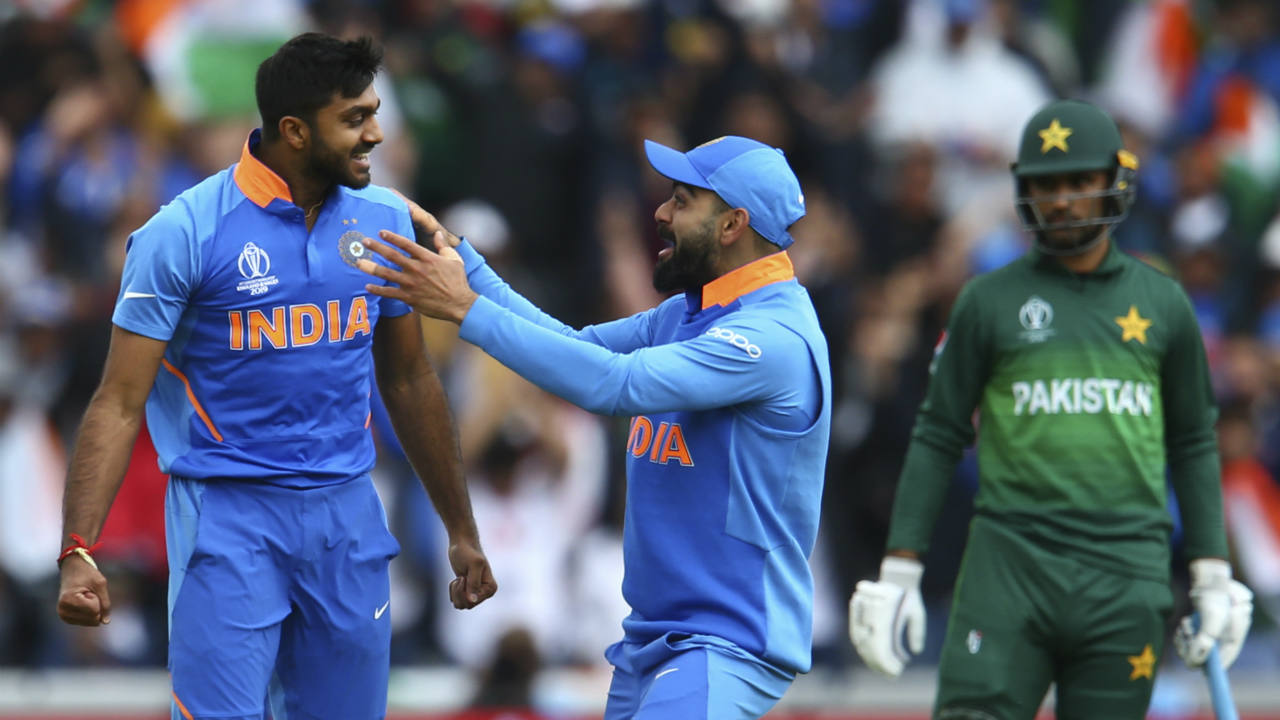 Bhuvneshwar Kumar slipped while bowling in the 5th over and had to return to the dugout for treatment after just 4 deliveries. Kohli brought on Vijay Shankar to complete the over and the all-rounder struck with his very first delivery trapping Imam-ul-Haq LBW. (Image: AP)