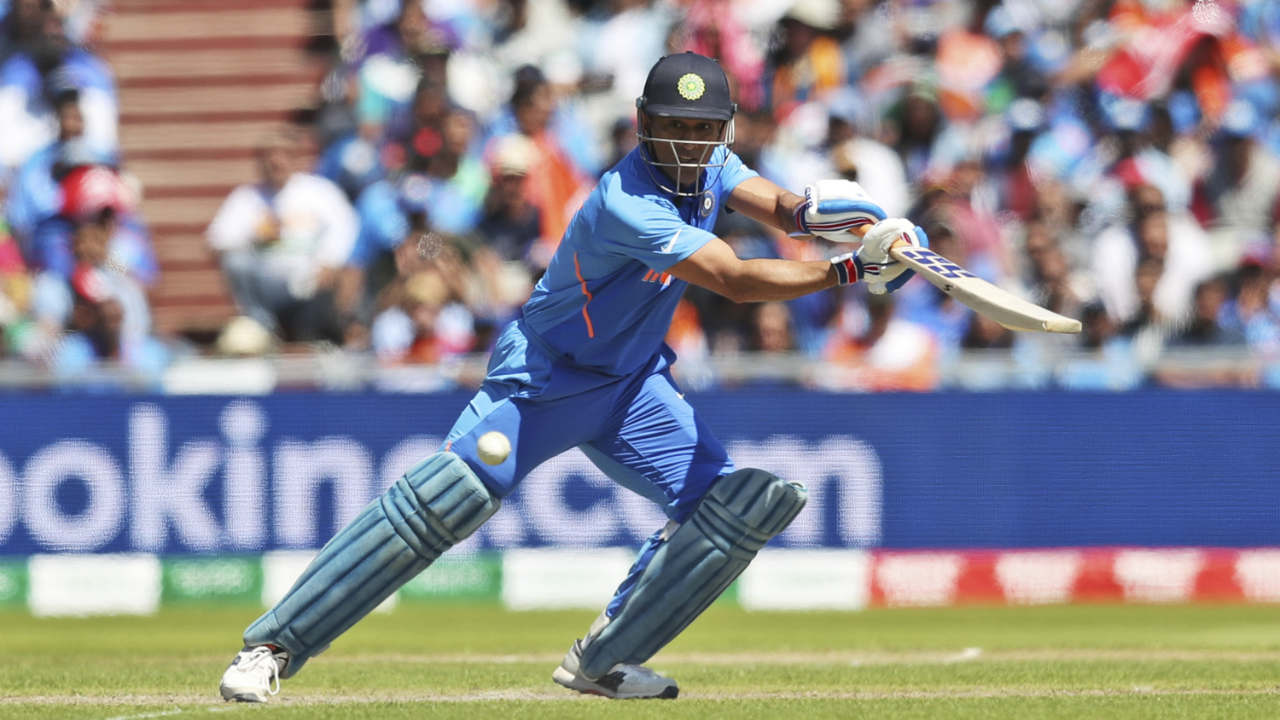 Dhoni was agonisingly slow at the start of his inning putting pressure on the batsmen at the opposite end. He picked up pace in the final over hitting Oshane Thomas for a 6 and 4 to bring up his fifty off 59 balls. India finished with 268/7 after 50 overs. (Image: AP)