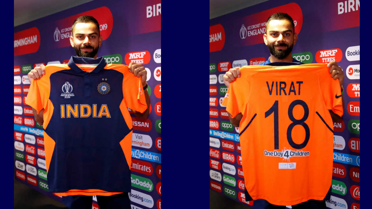 """Earlier in the day, Virat Kohli officially unveiled Team India's new jersey which they will don for the England game. A second jersey is required by India as part of ICC's new rule which states that in case the kits of the playing teams are of the same colour, the """"away"""" team will wear alternate colours. (Image: Reuters)"""
