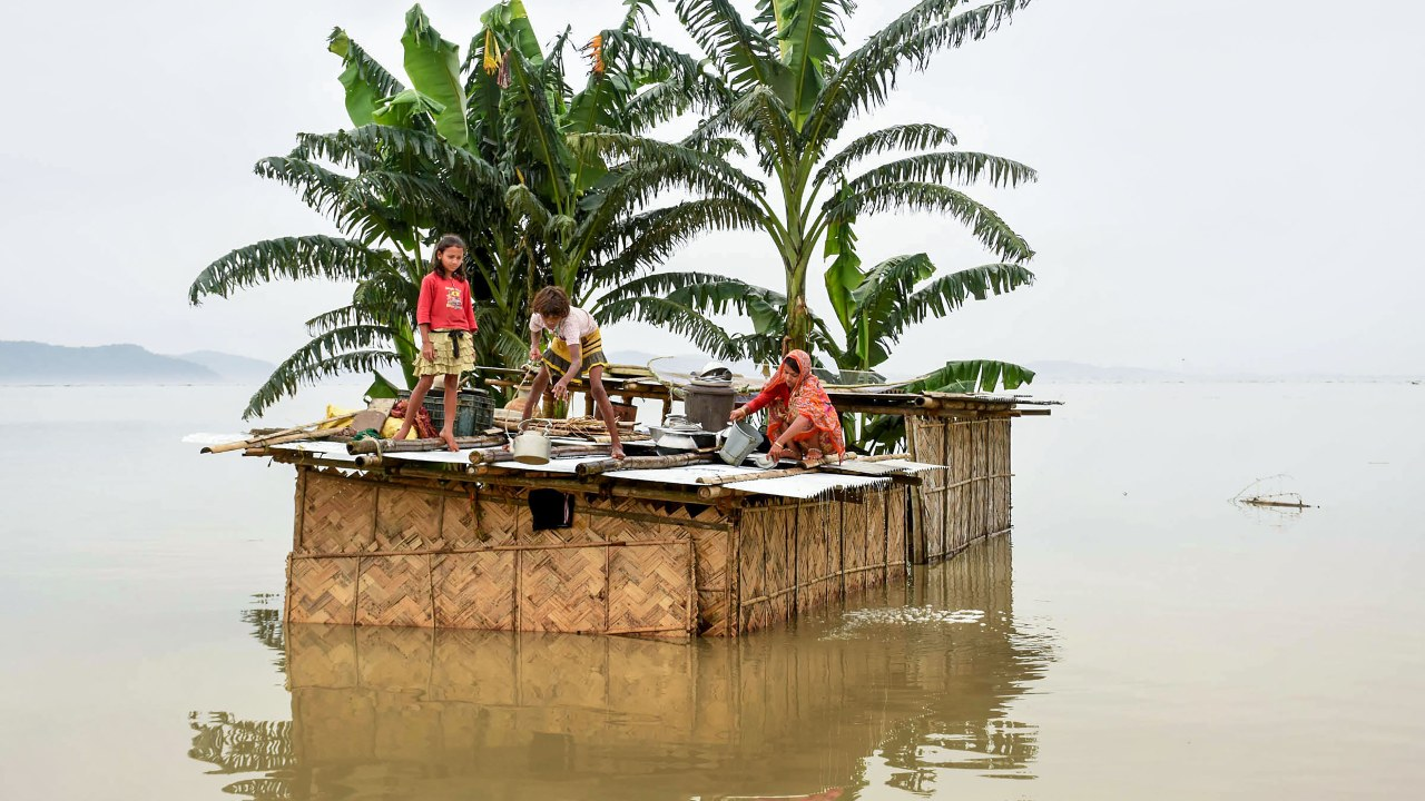 At least 15 teams of the National Disaster Response Force (NDRF), comprising 380 personnel, have been deployed in the state to tackle the situation. They have rescued 2,500 people between July 11 and July 15. However, at least 15 people have lost their lives to the floods. (Image: PTI)
