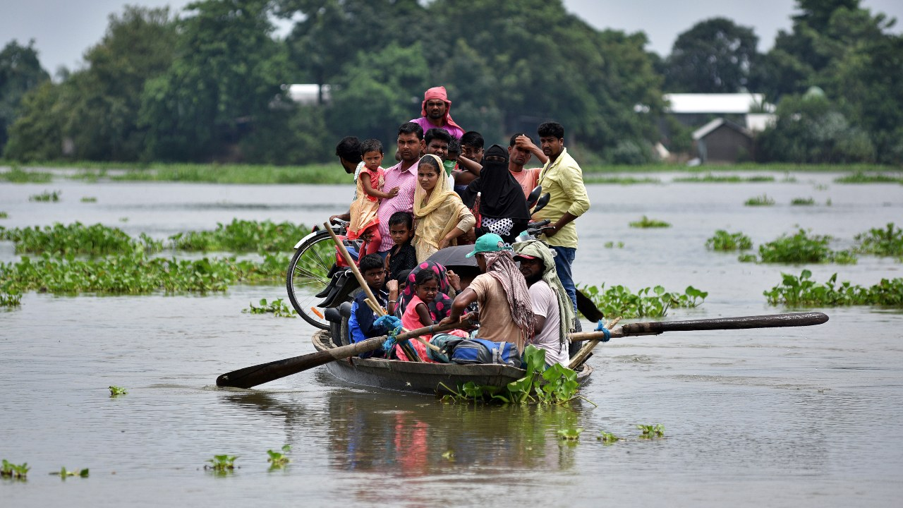 Around 43 lakh people have been affected by these floods. Seen here is affected villagers taking shelter on the roof of their submerged houses in Katahguri village along the river Brahmaputra, east of Gauhati. (Image: Reuters)