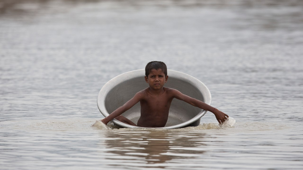 """River Brahmaputra, which flows through Guwahati in Assam, crossed the danger mark on July 15. The Central Water Commission said that the water level is rising by 2-3 centimetres per hour, which can be a """"danger for the city"""". (Image: AP)"""