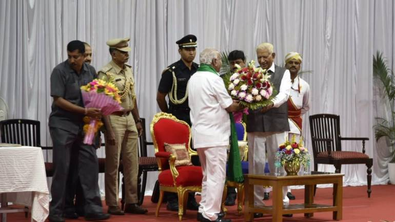 BJP Karnataka chief BS Yediyurappa congratulated by Governor Vajubhai Vala after he took oath as the Karnataka Chief Minister for the fourth term. (Image: Twitter)