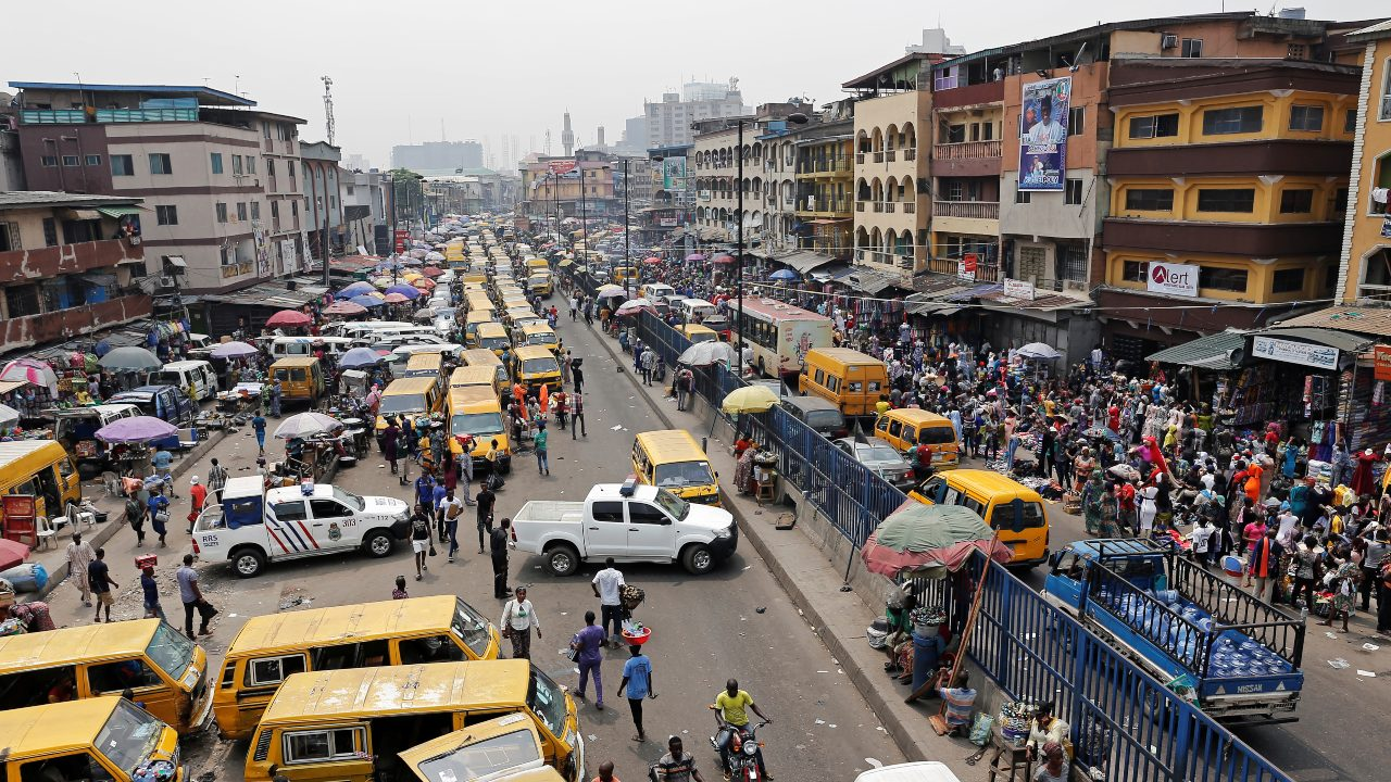 Lagos, Nigeria | Lagos is the economic and cultural powerhouse of Nigeria, thanks to an influx of oil money. Besides, the city has an emerging arts and music scene to keep its inhabitants content post dawn. Seen here: Idumota Market and a bus park in Lagos. (Image: Reuters)