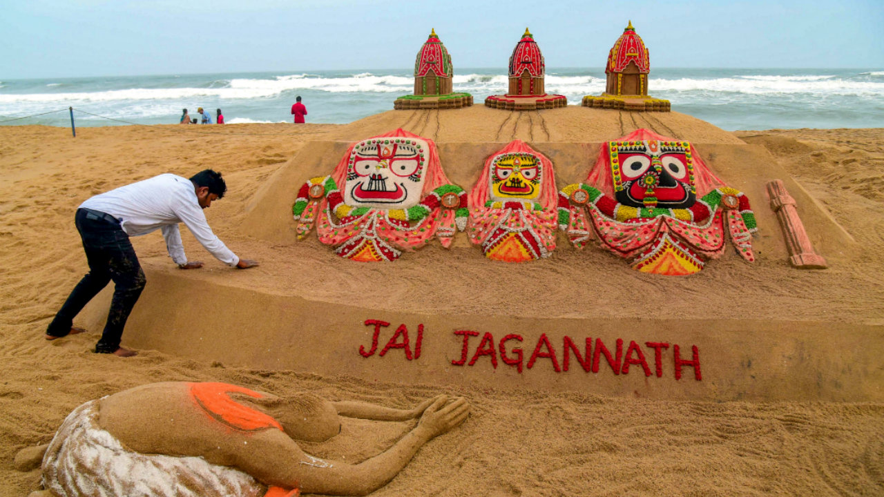 The Odisha government has deployed over 10,000 security personnel for the occasion. In this picture, sand artist Sudarshan Pattnaik creates a sculpture on the eve of Rath Yatra festival, at a beach in Puri, Odisha. (Image: PTI)