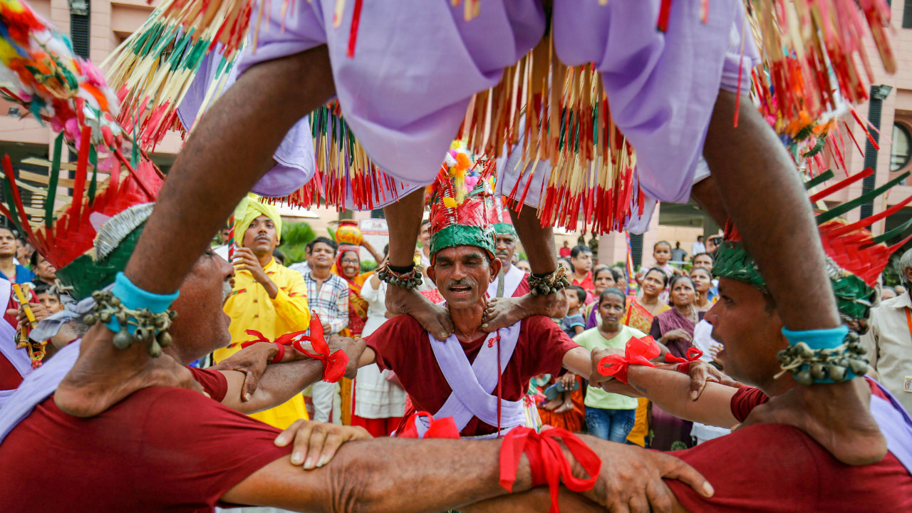 The President of India, Ram Nath Kovind; the Vice President, Venkaiah Naidu and the Prime Minister of India, Narendra Modi, have greeted the people on the occasion. In this picture, devotees create a human pyramid as they perform a tribal dance on the eve of the annual Rath Yatra or Chariot procession, in Ahmedabad. (Image: PTI)