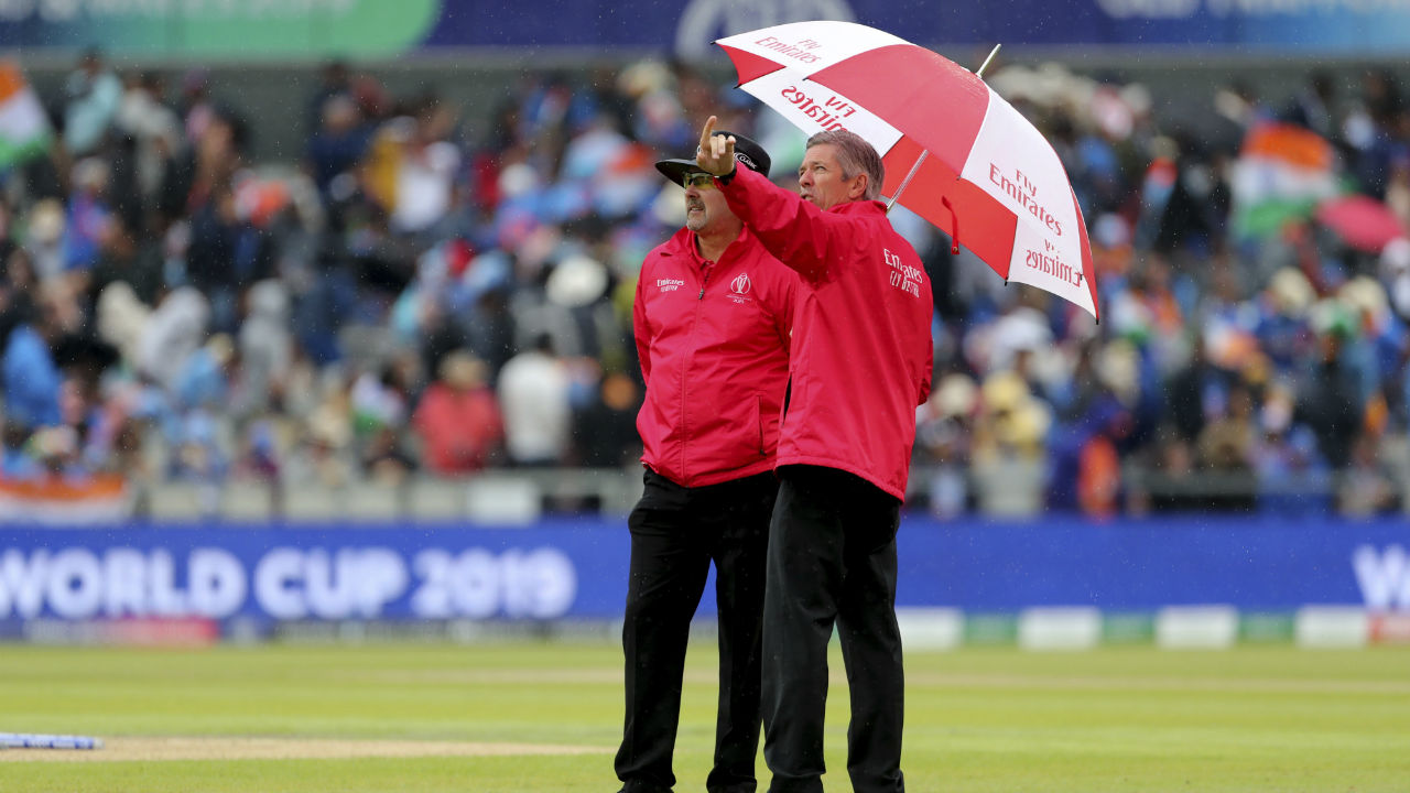 After four hours of incessant rains, umpires Richard Illingworth, Richard Kettleborough were forced to call off the play. The match resumes at 3.00 PM IST on July 10. The match restarts from the point where it stopped. (Image: Reuters)