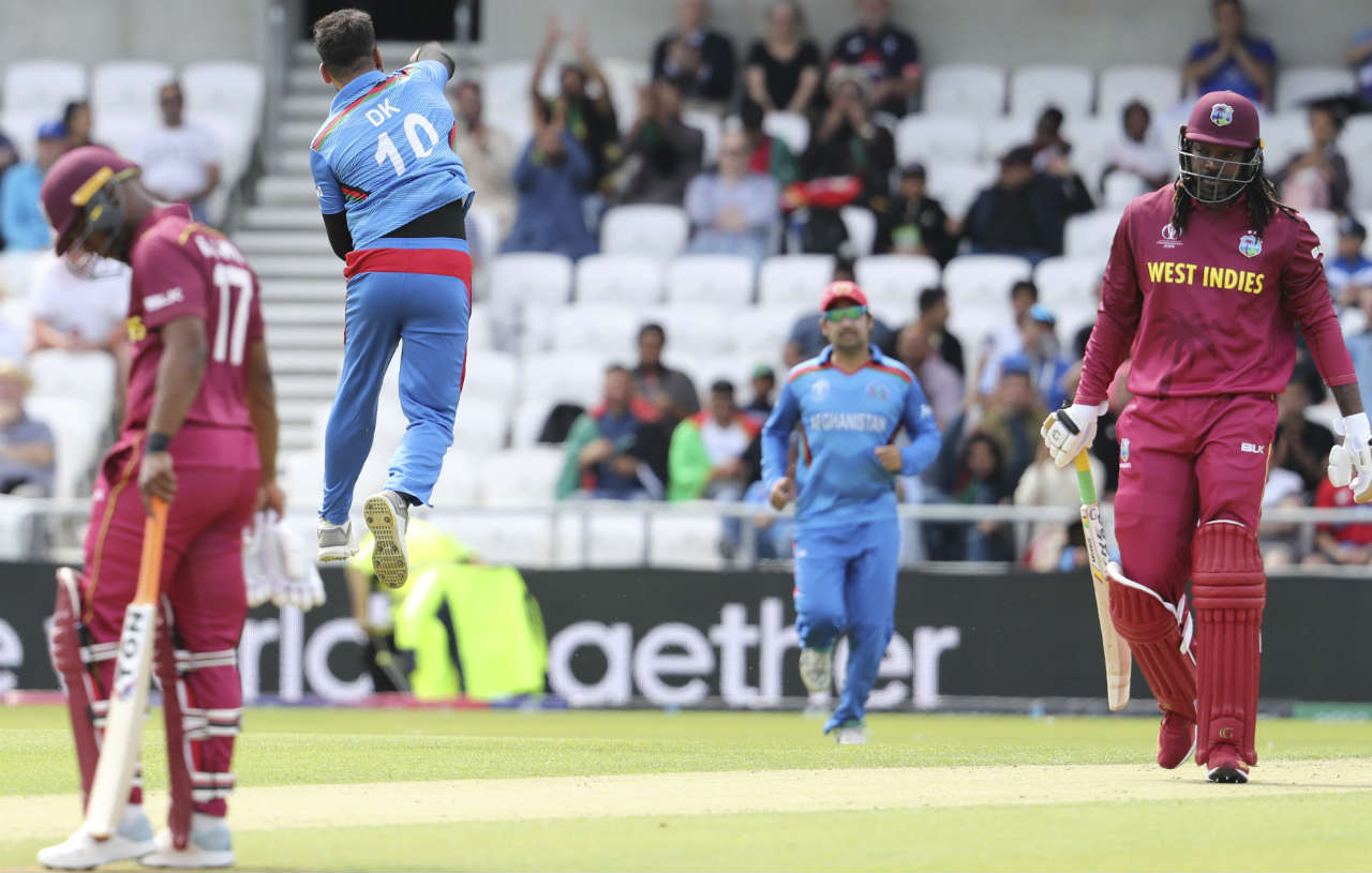 Chris Gayle in probably his last World Cup outing couldn't do much as he slashed at a full delivery outside off in the 6th over and only ended up edging back to the keeper. Dawlat Zadran was the bowler who got the breakthrough for Afghanistan. (Image: AP)