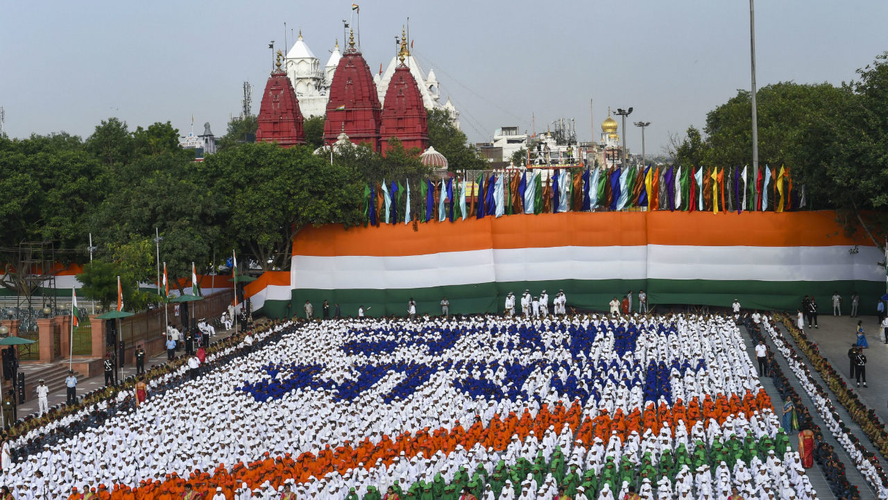 School children form a tricolour during the full dress rehearsal for the 73nd Independence Day function at the historic Red Fort, in New Delhi on August 13. (Image: PTI)