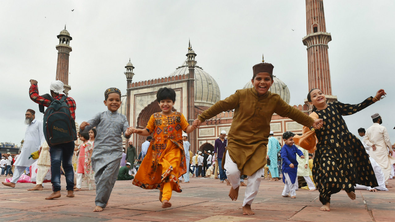 Muslim children are jubilant at the Jama Masjid on the occasion of Eid al-Adha in New Delhi on August 12. Muslims across India, and the world, celebrated Eid al-Adha, or the Feast of the Sacrifice, by sacrificing animals to commemorate the prophet Ibrahim's faith in being willing to sacrifice his son. (Image: PTI)