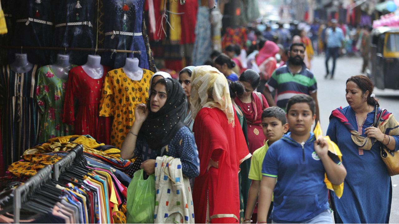 People shop at a market on the eve of Eid al Adha in Jammu, Jammu and Kashmir on August 11. (Image: AP)