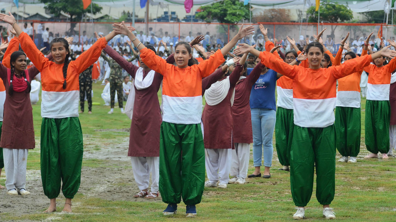School students perform during the full dress rehearsal for Independence Day parade, at Mini Stadium in Jammu, Jammu and Kashmir on August 13. (Image: PTI)