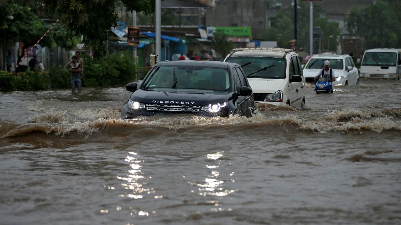 Vehicles move through a water-logged road after heavy rains in Ahmedabad, Gujarat on August 10. (Image: Reuters)