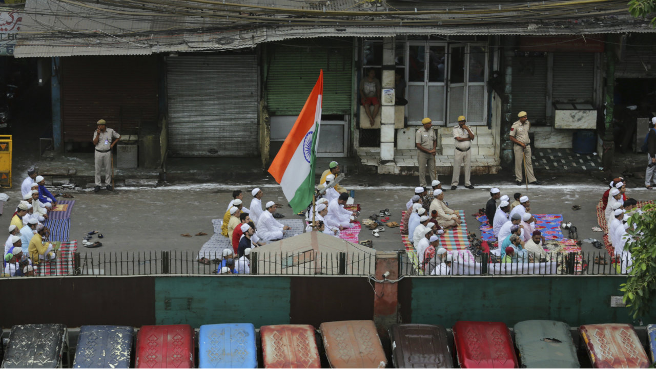 Muslims offer prayers on the road outside Jama Masjid in New Delhi. (Image: AP)