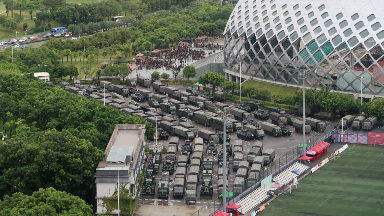 Chinese paramilitary officers and vehicles are seen at the Shenzhen Bay Sports Center in Shenzhen near the border with Hong Kong, China on August 17, 2019. The armed police have been holding anti-riot drills since they assembled there. The drills have been seen as a warning to Hong Kong protesters. (Image: Reuters)
