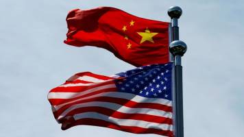 China says it hopes to reach phased trade pact with US as soon as possible