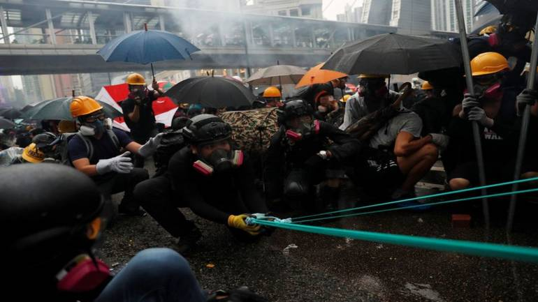 China rotates its troops in HK garrison; rally banned