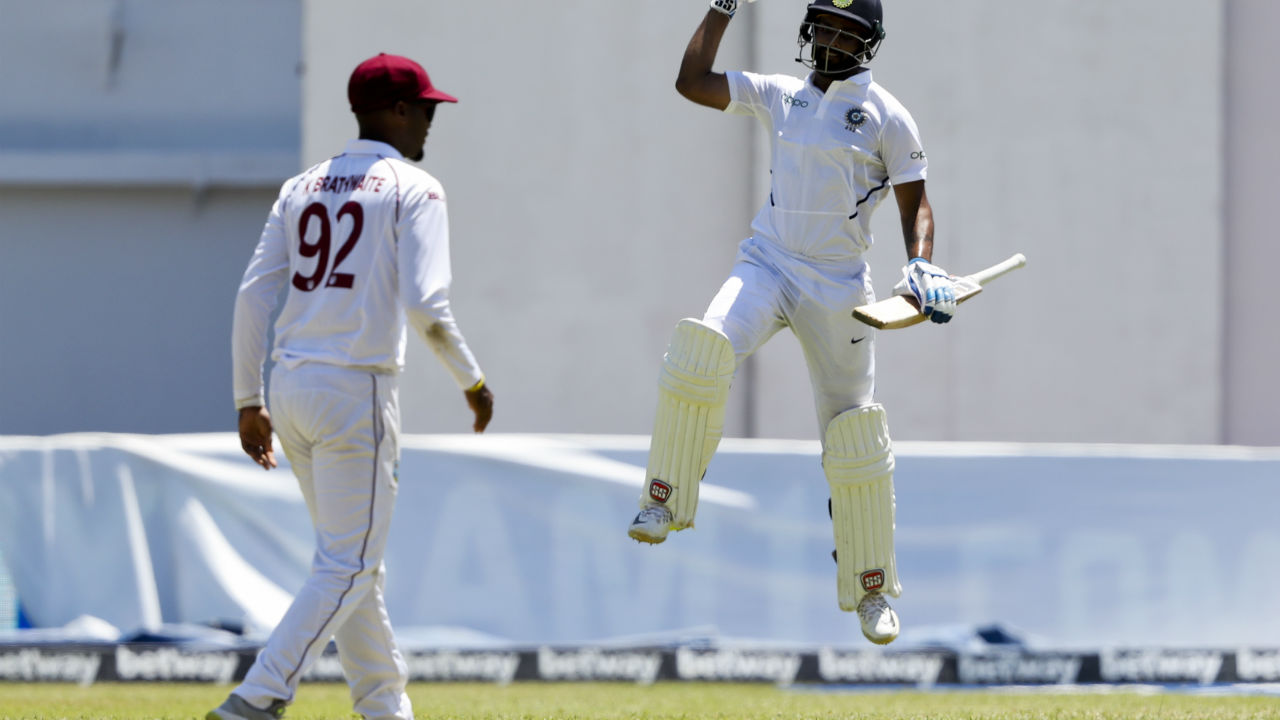 Vihari and Ishant resumed India's progress after Lunch and Vihari completed his maiden Test ton with a single off a delivery from Kemar Roach. (Image: AP)