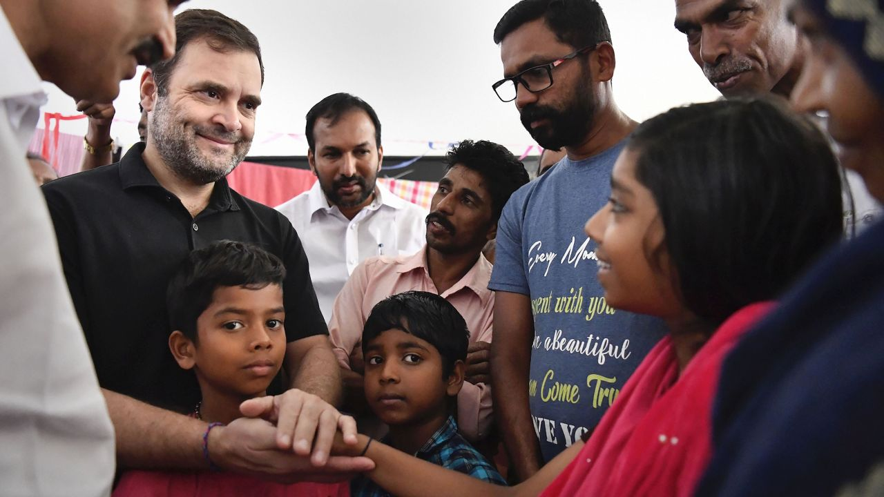 Congress leader Rahul Gandhi interacts with a flood-affected family at St Jude's Shrine flood relief camp, Chundale, Wayanad, Kerala. (Image: PTI)
