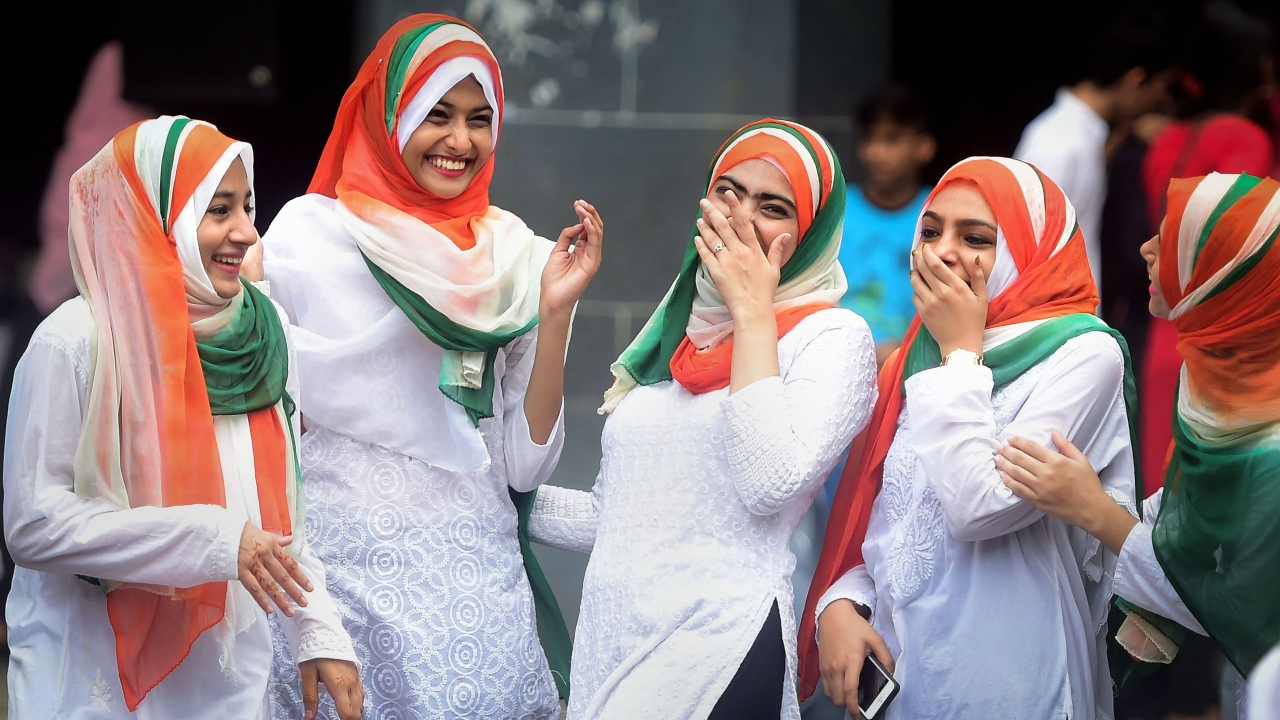 Students from the Anjuman Islam school share a light moment as they participate in the 73rd Independence Day celebrations, in Mumbai, Maharashtra (Image: PTI)