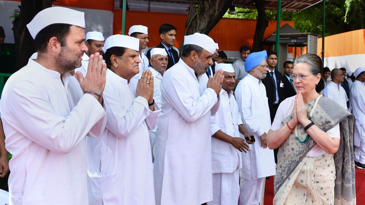 Congress' interim President Sonia Gandhi greets party leaders as she arrives to hoist the tricolour during the Independence Day celebrations at the AICC office, in New Delhi. (Image: PTI)