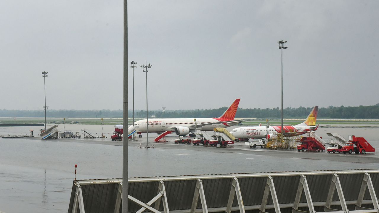 Planes stand parked at Cochin International Airport as all operations were suspended following waterlogging on the runway, in Kochi. According to authorities, services will remain suspended until Sunday (August 11 ). (Image: PTI)