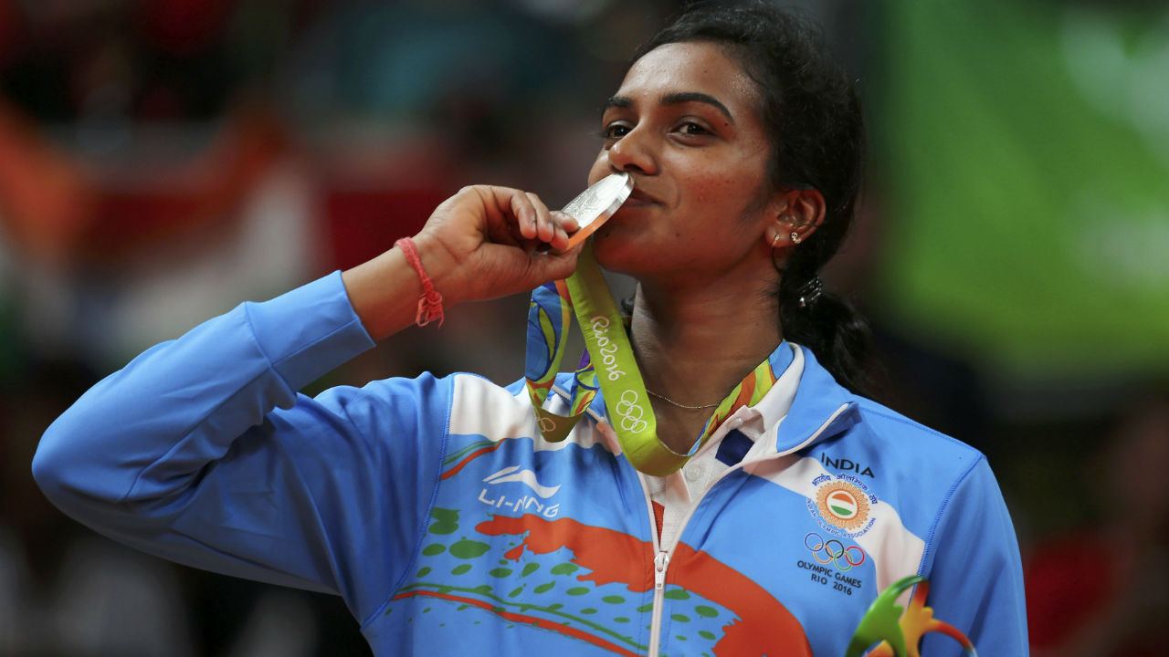 The 5'10 inch lanky player also holds the record of being the first Indian singles player to win a silver medal at the Olympics. Sindhu created history in Rio 2016 when she lost the singles final against Spain's Carolina Marin 19-21 21-12 21-15. (Image: Reuters)
