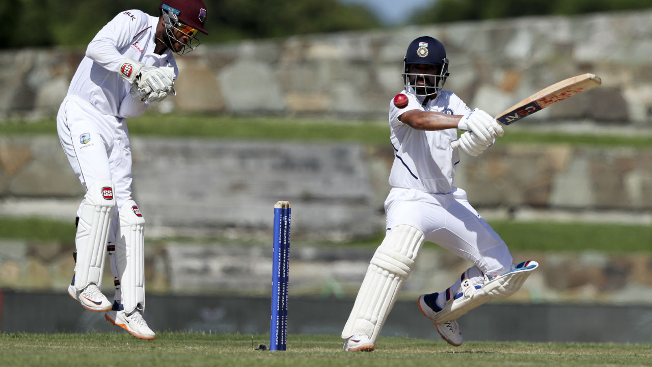 Rahane found some good support in Hanuma Vihari following the wicket of Rahul. He soon brought up his 18th Test half-century off 117 balls before rains forced an early Tea. India were placed at 134/4 going into Tea. (Image: AP)