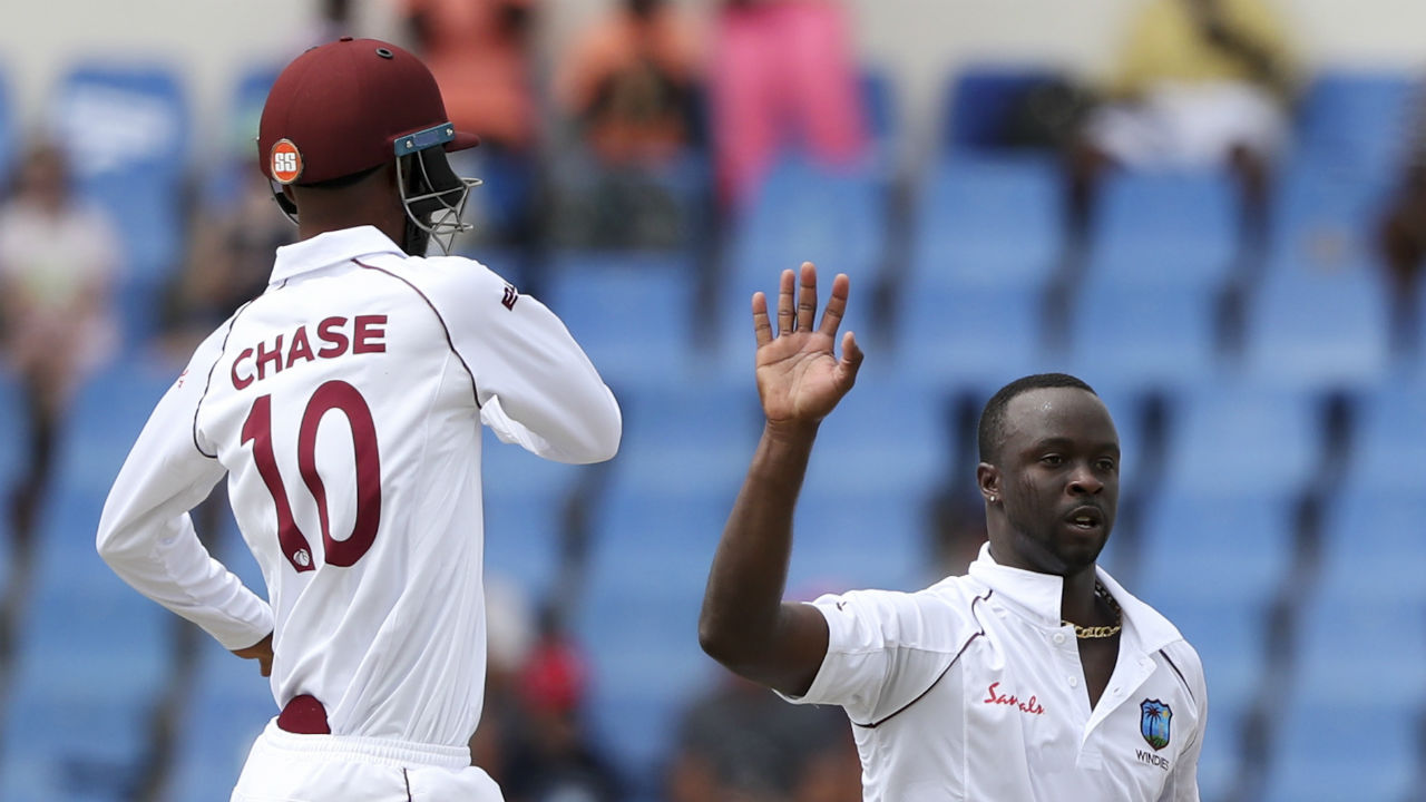 Kemar Roach sent early tremors through the Indian batting lineup as he removed Agarwal and Cheteshwar Pujara early in quick succession. Agarwal made 5 and Puajar made 2 as India were 7/2. (Image: AP)
