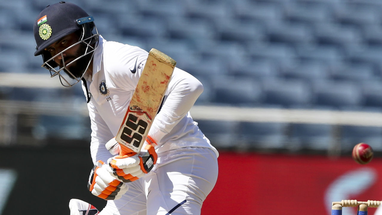 Ravindra Jadeja struggled to get runs and scored a patient 16 from 69 deliveries before he went for an aggressive shot against Rahkeem Cornwall but holed a catch to Darren Bravo at mid-on. India were 303/7 at the end of 111 overs. (Image: AP)