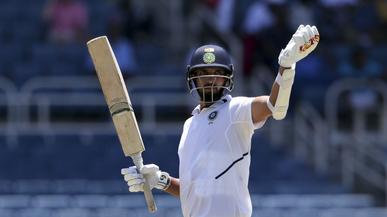 Ishant too impressed with the bat and soon brought his maiden half-century. Ishant and Vihari frustrated the West Indies bowlers with a 100-run partnership. (Image: AP)