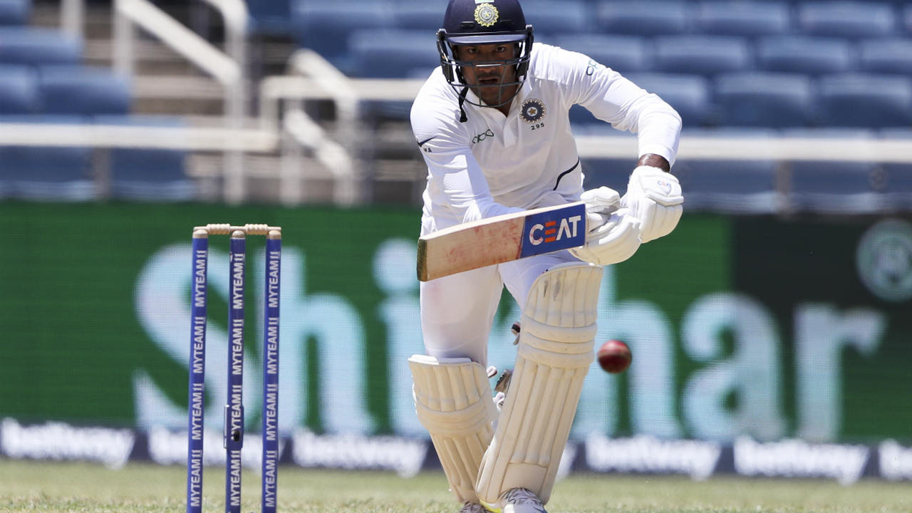 Agarwal got lucky with two streaky boundaries against Roach in the 38th over which brought up his 3rd Test Fifty coming off 117 balls. He was then given OUT caught behind off the 1st ball from Roach in the 40th over but Agarwal went for the review which showed the ball was missing the edge. (Image: AP)