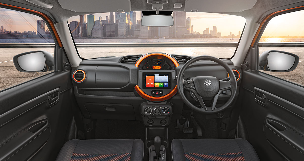The interior gets a Mini-styled circular housing, which encloses a fully digital speedometer with a 7-inch touchscreen infotainment system. This system is expected to support phone app connectivity. (Image source: Maruti Suzuki)