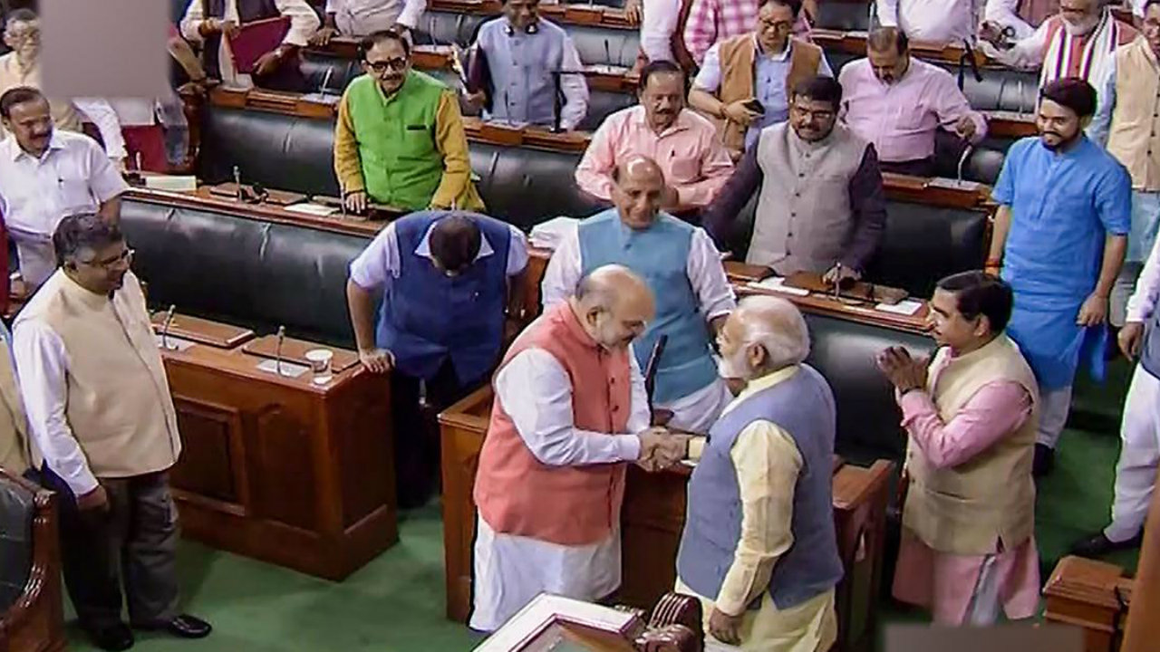 August 5, 2019: In one of the first major steps by the government after storming to power for a second term, provisions of Article 370 of the Indian Constitution, granting special status to the state of Jammu and Kashmir was scrapped. In this picture, Home Minister Amit Shah is seen with PM Modi after a Bill to bifurcate J&K was passed in Lok Sabha. (Image: PTI)