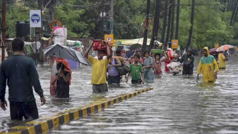 Floods hamper normal life as floodwater swamps roads in India