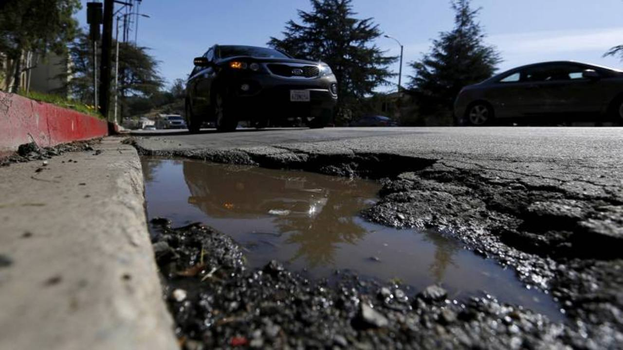 Though the National Highways Authority of India has added new stretches of highways to the national grid in the past few years quality of roads within cities remains poor. Potholes cropping up claiming lives have become a common occurrence especially during monsoons (Image: Moneycontrol)