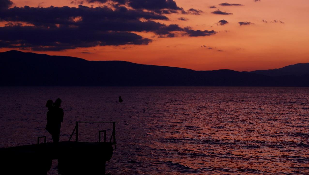 People enjoy the sunset on the coast of Ohrid lake, North Macedonia July 23, 2019. REUTERS/Ognen Teofilovski - RC1F94012380
